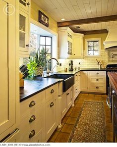 White kitchens can feel a little sterile to me.  I love how warm this kitchen is.