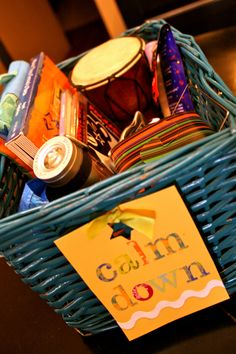 Calm Down Basket.  A basket just for my toddler, filled with his favorites to help soothe him when the tantrums start: cd's, books, flashlight, glow stick, snow globe, drum, pictures