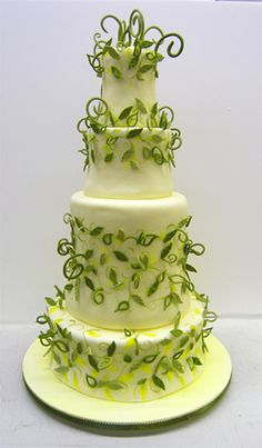 green and yellow leaves in horizontal design on each tier of this spectacular cake