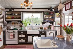 For an avid cook and gardener, there are two sinks in this kitchen. One is a large farmhouse sink with a pro dishwashing faucet to speed produce prep. The other is an island sink to handle overflow.