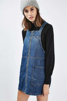 Give denim a cool spin in this PETITE MOTO utility style pinafore dress. A boxy silhouette cut with a square neckline and deep patch pockets to the front. Team it with a simple tee to finish the look.
