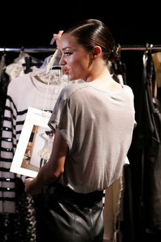 Miranda Kerr looks at a clothes rack backstage ahead of the David Jones Autumn/Winter 2010 Fashion Launch at the Hordern Pavilion on February 10, 2010 in Sydney, Australia.