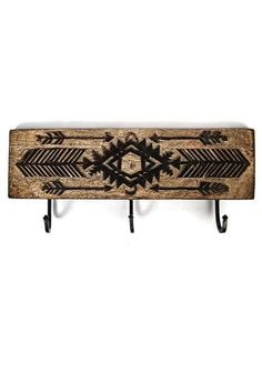 This Triple Arrow Hook features three metal hooks on a timber board with carved tribal-inspired patterns. Timber Boards, Modern Bohemian, Outdoor Furniture, Outdoor Decor, Wall Hooks, Arrow, Law, Carving, Home Decor
