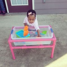 DIY Water Table-My husband made this water table for our daughter using PVC pipes and a storage container. Of course I spray painted it pink ;-)