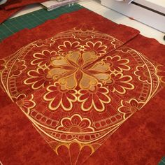 """Center block of """"Sewn Seeds"""" by Hoop Sisters. The four blocks are not sewn together yet to make the center block, but this shows what it is going to look like!"""