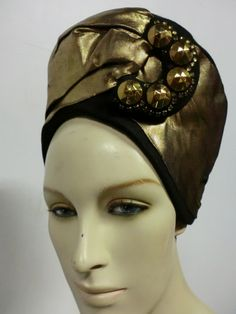 'Turban' style felt hat embellished with antiqued gold lamé and a leather backed glass stud | United States, 1940's