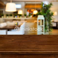 Wooden table on blurred room interior background