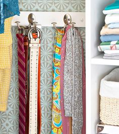 If space is available, store belts and scarves by hanging them on hooks mounted on the wall. Or you could roll them up and store them in a labeled box.