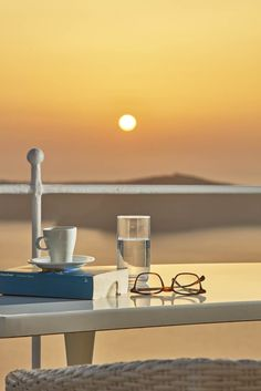 A good book, a cup of Greek coffee and the legendary sunset of Santorini... Enjoy a relaxing afternoon with the classics at Astra Suites!