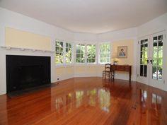- living room with gleaming wood floors & multi-paned windows