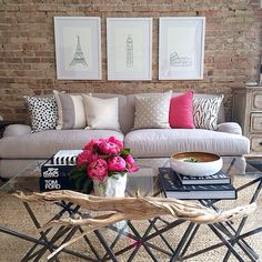 greige living room with pops of hot pink, black and white.