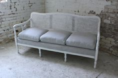 cane back sofa for rent from Mrs. Vintage