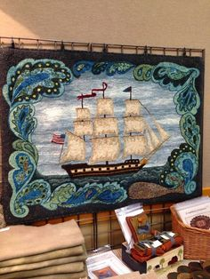 ANN ARBOR HOOK IN Oliver Cromwell, designed by Edyth O'Neill and hooked by Lynne Kossarek 2012. Picture of Lynne 's booth