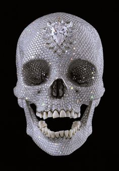 For the Love of God (2007) Created by Damien Hirst.  In 2007, art historian Rudi Fuchs, observed: 'The skull is out of this world, celestial almost. It proclaims victory over decay. At the same time it represents death as something infinitely more relentless. Compared to the tearful sadness of a vanitas scene, the diamond skull is glory itself. I'm going to use this as my template for my 'amused to death' skull.