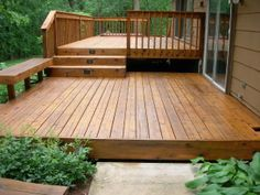 decks-handyman/ Simple two level deck with integrated bench and lighting on stairs.