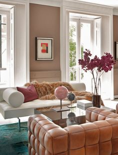 leather chair, the fur throw, the modern sofa, the pink & gray globes, divine.....