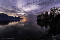 The Château de Chillon is an island castle located on the shore of Lake Geneva - Switzerland. Lake Geneva Switzerland, Scenery Pictures, What A Wonderful World, Wonders Of The World, Places To Go, Castle, Clouds, Sky, Island