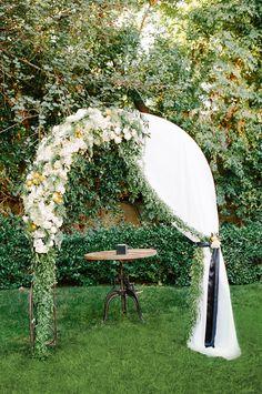 ceremony arch - photo by Krista Mason Photography http://ruffledblog.com/retro-modern-wedding-in-palm-springs