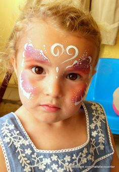 Elegant and easy butterfly face painting by Coral Murray