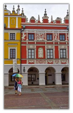 Zamosc market place on a rainy day. Zamosc is a charming and amazing renaissance style city in southeastern Poland around away from Ukraine. UNESCO World Heritage. See Zamosc on Wikipedia Colourful Buildings, The Beautiful Country, Central Europe, Historical Architecture, My Heritage, Old Town, Old Things, Wanderlust, House Styles