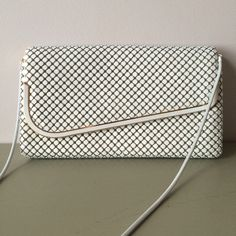 """A. Arton White Clutch White Metal Material. Cream Lining. White & Gold Hardware. Snap Closure. Interior has 1 Zip Pocket. Some wear on Interior Flap as Shown in 4th Picture. Bag is Clean. Can Hide Strap to Wear as Clutch or Wear as a Crossbody Measures 6""""H x 10.5""""L x 2""""D and Drop Length 20"""". ✅REASONABLE OFFERS NO TRADES NO PAYPAL A Arton Bags Clutches & Wristlets"""