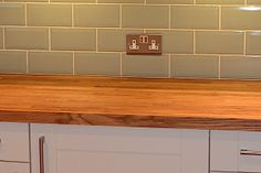 Solid Oak worktops, combined with the brick effect tiles offer a more traditional feel to this kitchen. Kitchen Worktop, Kitchen Tiles, Kitchen Layout, New Kitchen, Kitchen Decor, Kitchen Design, Kitchen Stuff, Brick Effect Tiles, Kitchen Kapers