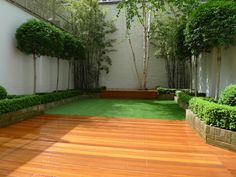 chelsea garden design hardwood decking artificial grass mature topiary and bamboo planting