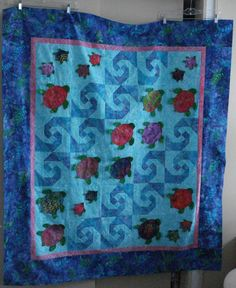 Baby quilt with turtles- I like how they did the waves.i think its this one.