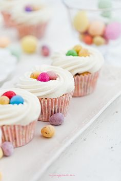 """...easter cupcakes...love the colors...recipe includes """"particles of chocolate"""" (looks like choc shavings)...icing recipe included..."""