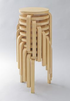 Stool 60 by Alvar Aalto - Three legged stool stacking ability