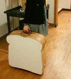 Bread-shaped travel case [would so use this as a portfolio to show that I was on the way to earn my daily bread]