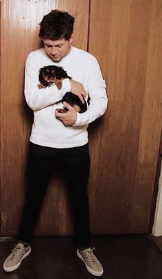 Two of my favourite things Niall Horan and Puppies!!!!