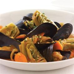 Cook mussels and artichoke hearts in an aromatic broth for an extraordinary main dish. A topping of Hazelnut Gremolata adds bright lemony flavor with a nutty crunch.