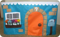 Felt playhouse. Another tablecloth playhouse. This one is felt, with lots of activities on it.