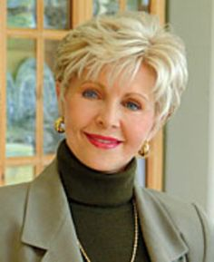 """Gloria Copeland has chosen a lovely cut and color that really is flattering. She either has very thick hair or has used gel and possibly the curling iron for her sweet """" do """""""