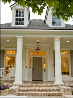 door color - The Taupe color of the door and shutters seem to go well with that color of brick Traditional Exterior Brick Design, Pictures, Remodel, Decor and Ideas - Exterior Paint Colors, Exterior Design, Brick Design, Paint Colours, Style At Home, Traditional Exterior, Traditional Porch, Architecture, House Colors