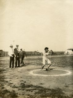 1904 Olympics: N. Georgantas of Greece, throwing the discus.