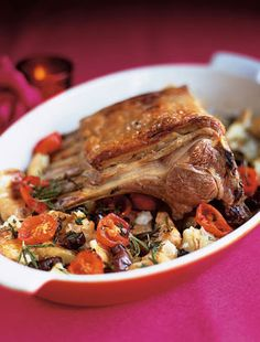 Roast rack of lamb with crushed potatoes With cherry tomatoes and olives