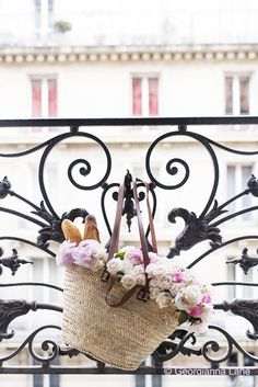 Market Flowers on the balcony of the Gamay apartment by Paris Perfect, photo by Georgianna Lane