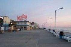 Watch the sunrise along the Rehoboth Beach boardwalk.