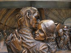 Detail from the base of the bronze cuddle or kiss by Paul Day in St Pancras Station [shared]