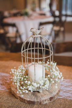 Birdcage, candle, babys breath rustic centerpiece on a wood round. Magnolia Plantation wedding in Charleston, SC.  Charleston wedding photographer.