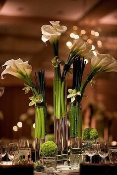Trio of Tall Glass Cylinders with White Calla Lilies and Green Cymbidium Orchids Accented with Mum Balls