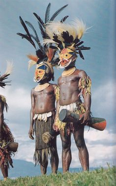 masked dancers, New Guinea      National Geographic 1953   E Thomas Gilliard and Henry Kaltenthaler