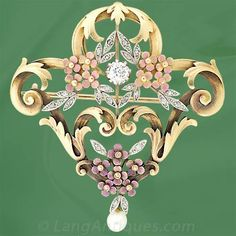Art Nouveau Enamel Pin/Pendant             18K Yellow gold and platinum Art Nouveau pin/pendant featuring one old mine cut diamond (.45 carat, I-J color, SI2 clarity) highlighted with 22 rose cut diamonds set in platinum leaves amongst clusters of pink enameled flowers with a drop pearl and scrolling foliate gold work. This pin measures 2 1/8 X 2.