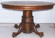 I remember inspecting these claw feet while playing on the floor. This table was traded for a simpler one.