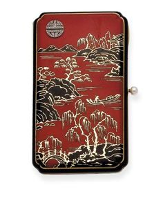AN ART DECO ENAMEL, DIAMOND AND GOLD VANITY CASE, BY LACLOCHE FRERES – Photo courtesy of Christie's