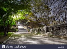 Download this stock image: Walkway and fortress wall (or City Wall) at the Namsan Hill (or Namsan Park or Namsan Mountain) in Seoul, South Korea, at night. - GFA3NJ from Alamy's library of millions of high resolution stock photos, illustrations and vectors.