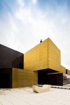 Platform of Arts and Creativity, Guimarães, 2012 by Pitágoras Arquitectos  #architecture #portugal #design #arquitectura #GUIMARÃES #yellow #gold #metal #textures