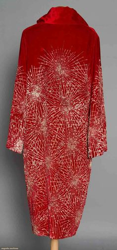 "RED VELVET OPERA COAT, 1920s Painted w/ irridescent gold starburst pattern, tubular long sleeves, ""Ann Waller Farrell Newport, Rhode Island & Miami Beach Florida"" label, cherry red silk lining, L 42.5"